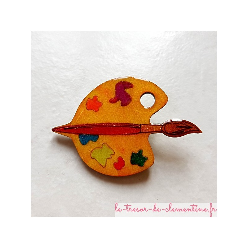 Cette Palette de peinture montée en broche avec son pinceau rouge est du plus bel effet, pour un cadeau original.