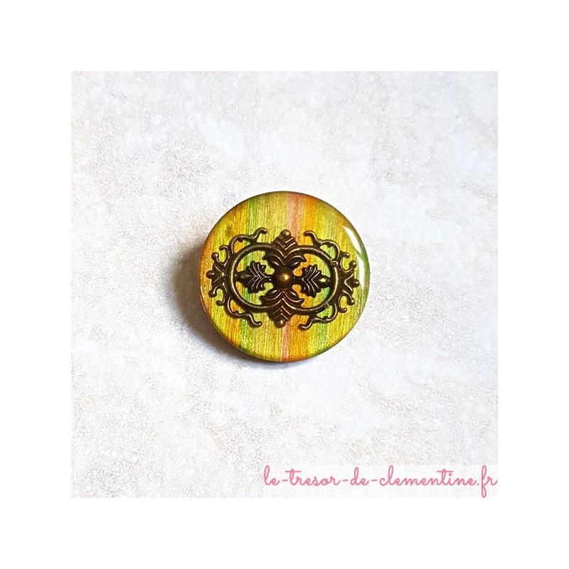 Broche vintage très originale tons mordorés et bronze forme ronde aspect émail