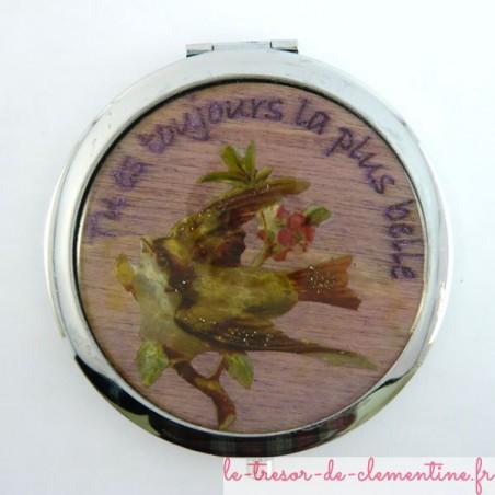 Miroir de poche décoré à la main d'un oiseau sur branche